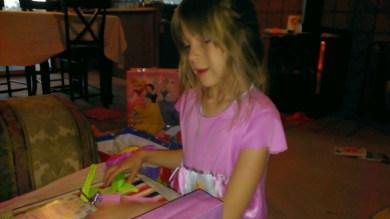 Haylee admiring her gift.