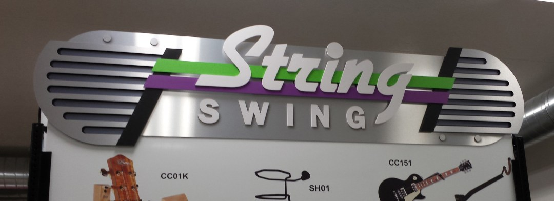 String Swings Art Deco Themed Trade Show Sign