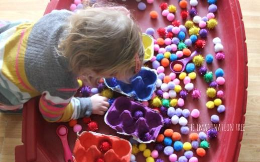 Pom-pom-colour-sorting-in-the-sensory-table