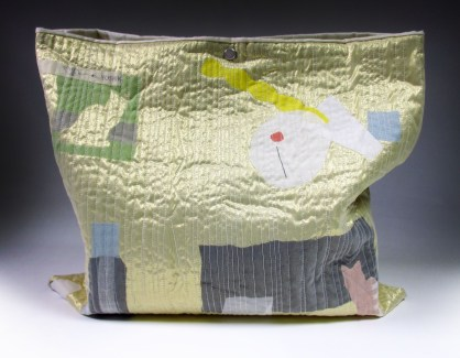 Project Bag done in a workshop led by artist Yoshiko Jinzenji, this piece is layered with sheer fabrics and fabric appliqués and then quilted.