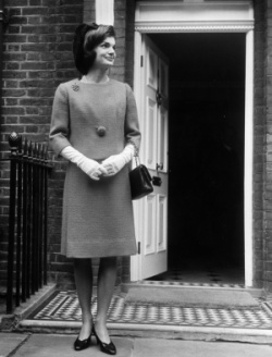 Jackie Kennedy holds her Chanel bag
