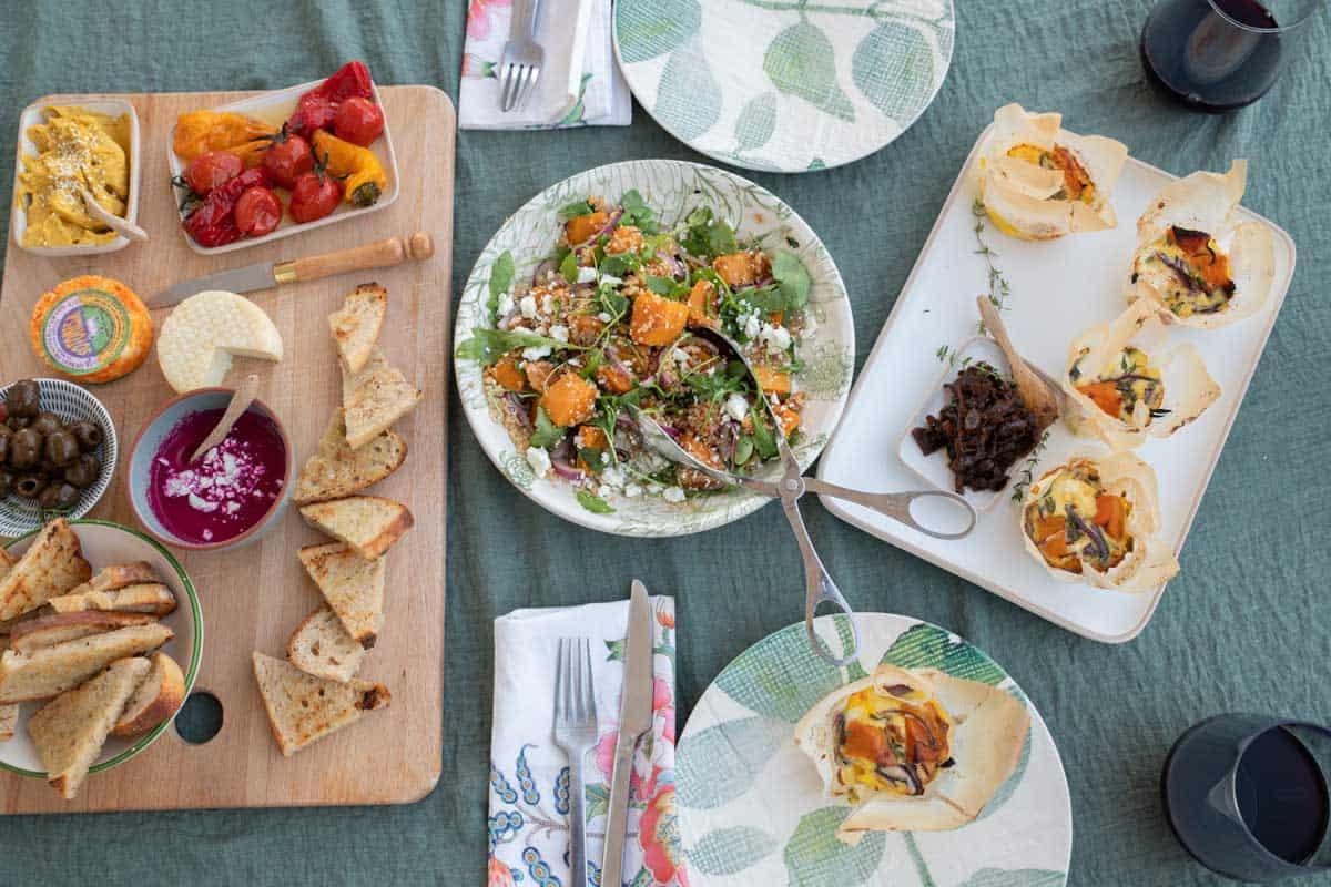 Fall inspired picnic spread with mezze platter, pumpkin quinoa salad and mii frittatas.