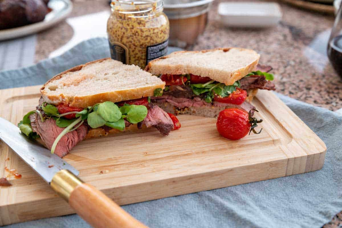 Rare roast beef sandwich on sourdough bread.