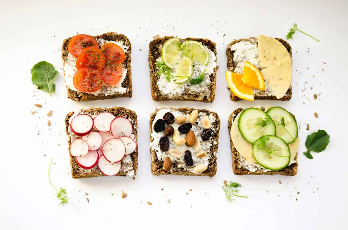 6 brightly arranged open sandwiches in rows.