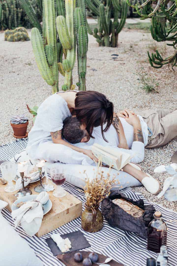 Young couple kissing at a romantic picnic