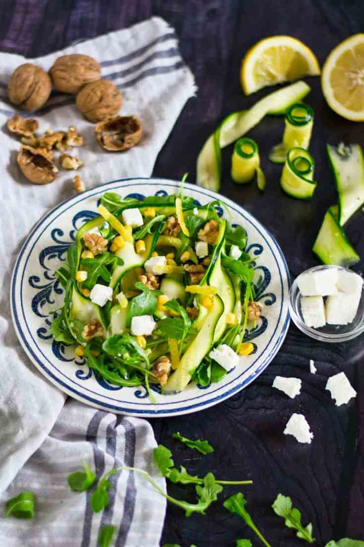 Colourful bowl of Zucchini salad with corn and feta.