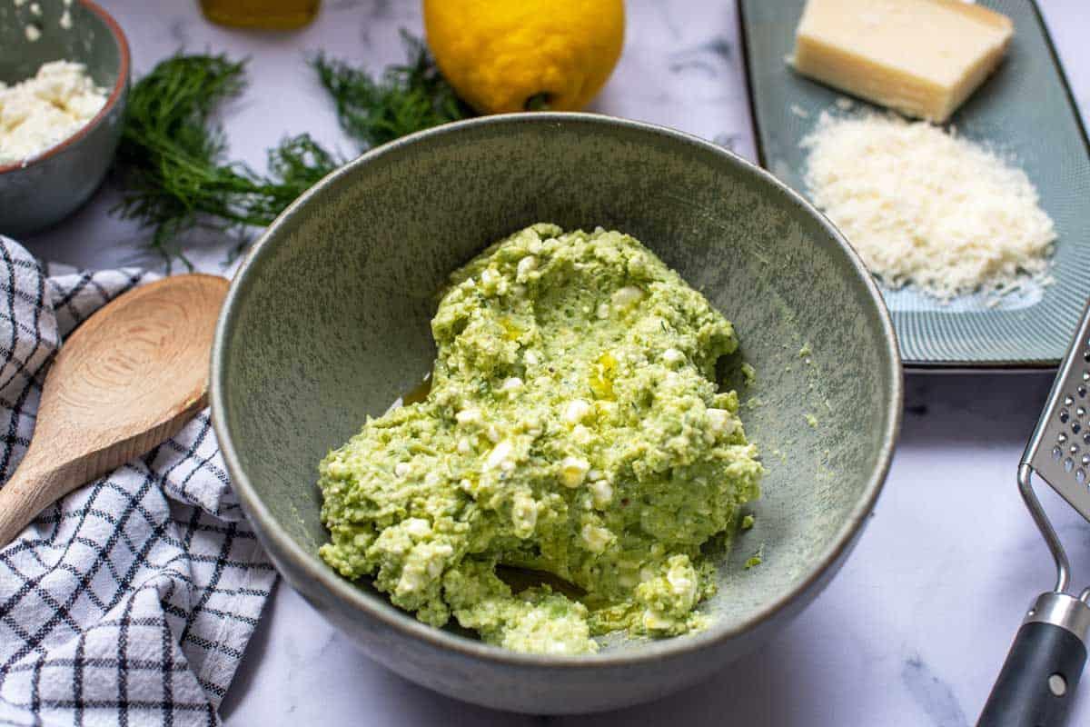 Bowl of parmesan pea spread.