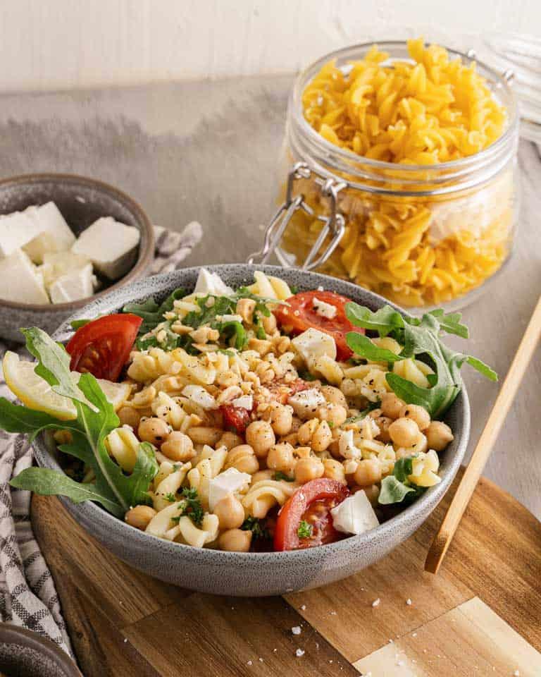 Bowl of chickpea and arugula pasta salad.