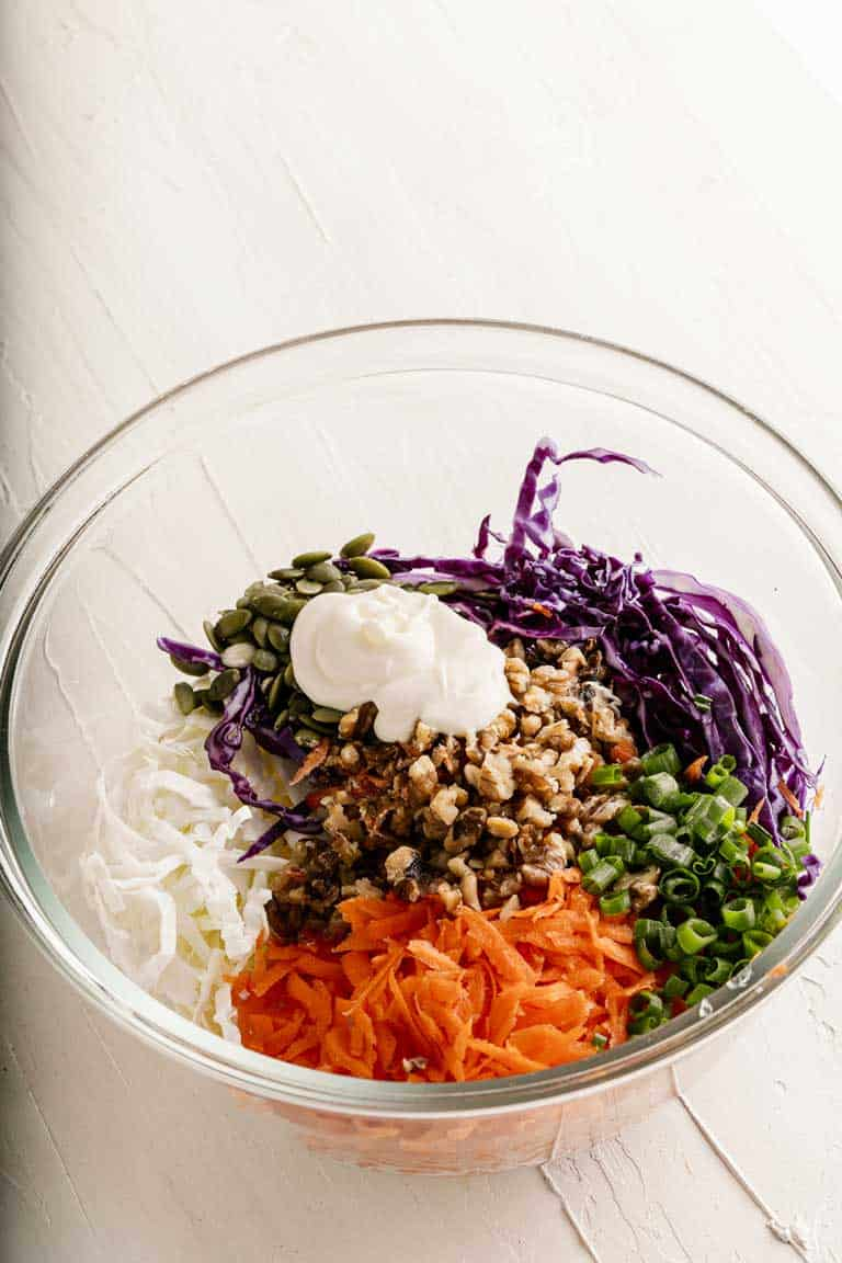 Coleslaw ingredients in a bowl before mixing.