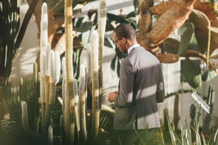 man in field in suit