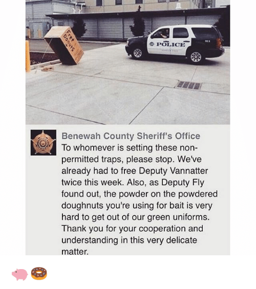 A police SUV is parked next to a box trap