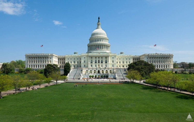 Charming Front View Of United States Capitol With Green And Sky Background