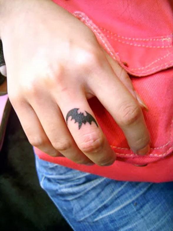 Cool Small Black Ink Bat Tattoo On Men Middle Finger