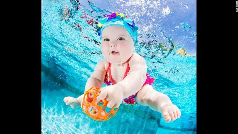 Cute Baby Girl Swimming Underwater