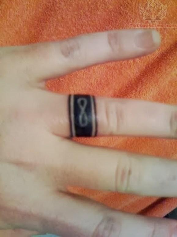 Fantastic Black Ink Infinity Ring Finger Tattoo For Women