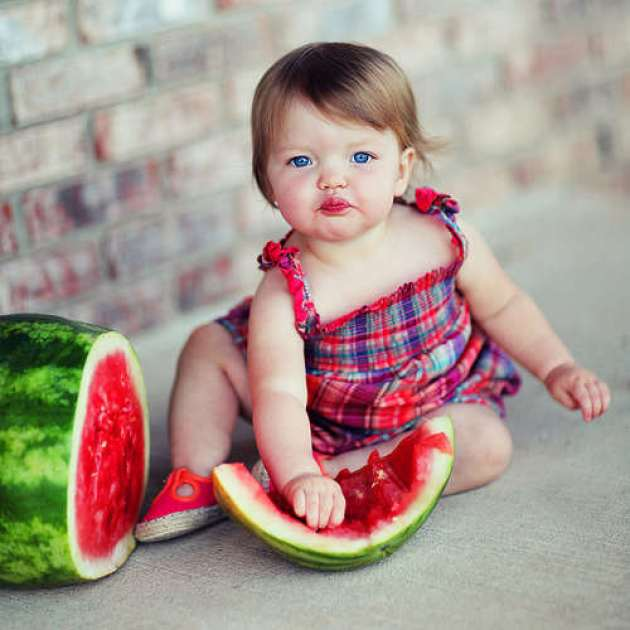 Little Baby Girl Eating Watermelon Picture
