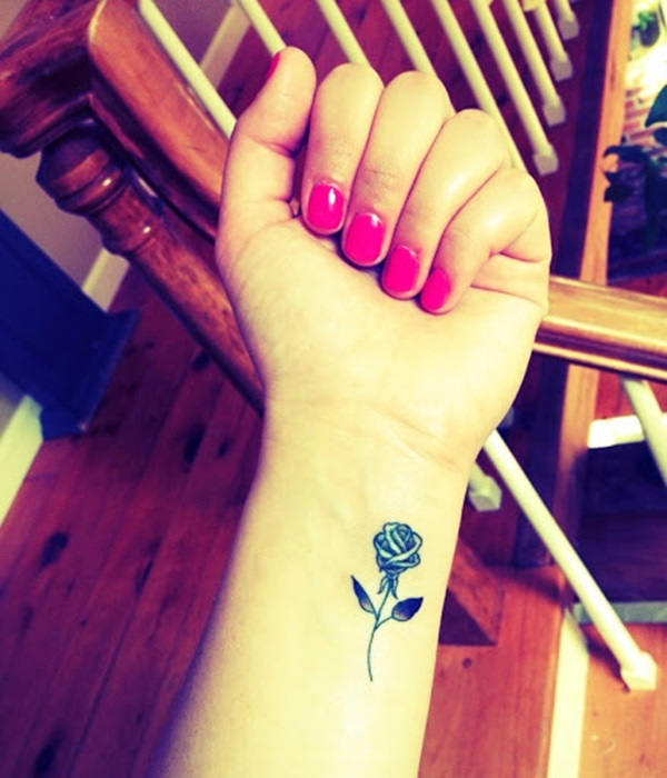 Outstanding Small Rose Tattoo Design On Girl Wrist