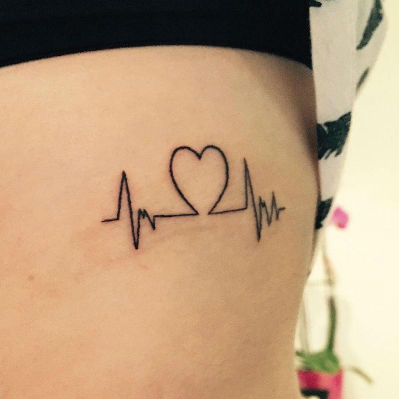 Simple Black Ink Heart Ekg Heartbeat Tattoo For Girl Ribs Side