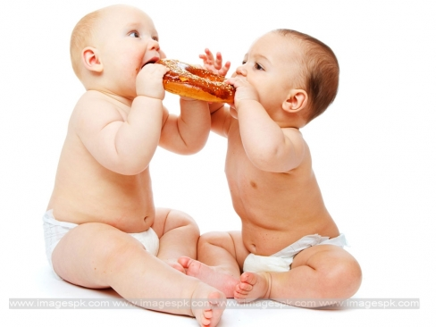 Twins Babies Eating Doughnut Picture
