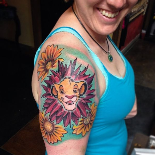 Women With Amazing Colorful Ink Animated Simba Lion Flower Tattoo On Shoulder