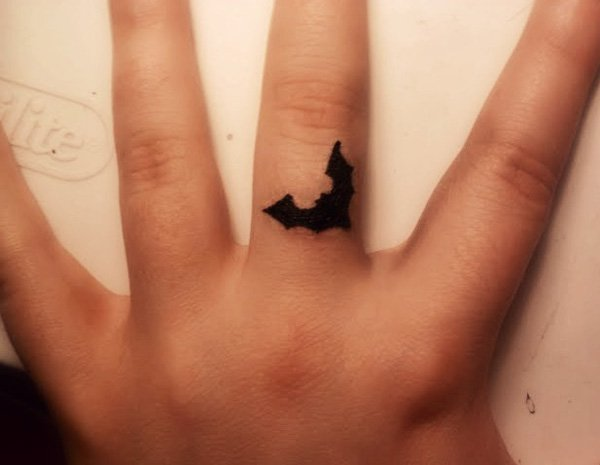 Wonderful Bat Tattoo On Finger With Black Ink For Man And Woman