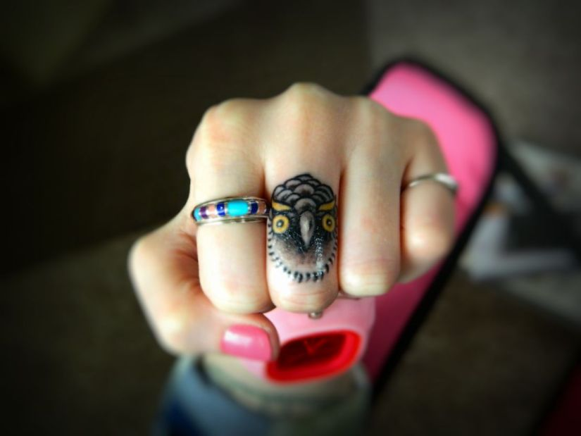 Wonderful Realistic Small Grey Ink Baby Owl Tattoo For Middle Finger
