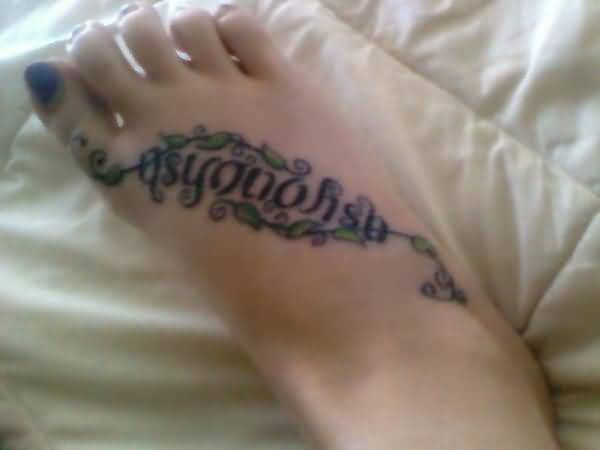 adorable green and blue color ink ambigram text tattoo on women's Leg made for women