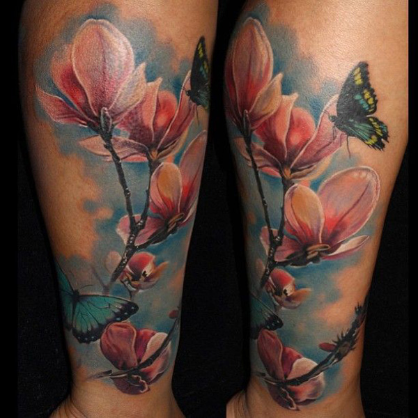 attractive Magnolia Tattoo by Laura Juan on leg With colourful ink For Man And Woman
