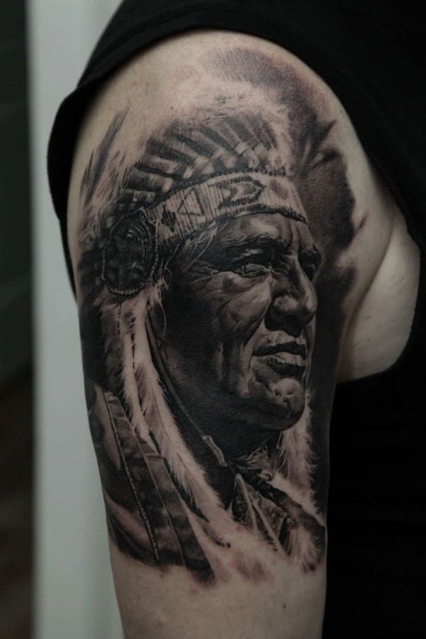 Attractive Native American Sleeve Tattoo On Arm With Black Ink For Man & Woman