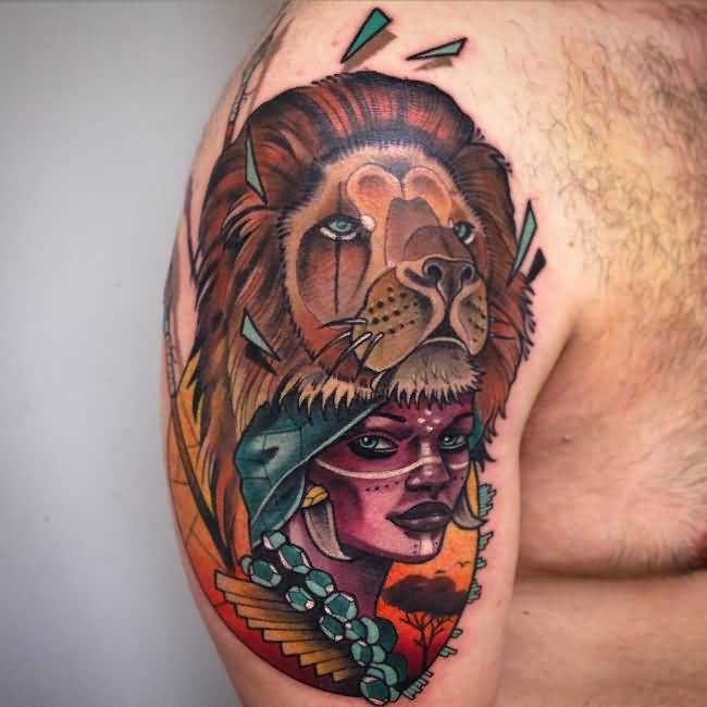 Attractive Colorful Ink Tatto Of African Girl With Lion Mask On Boy Shoulder