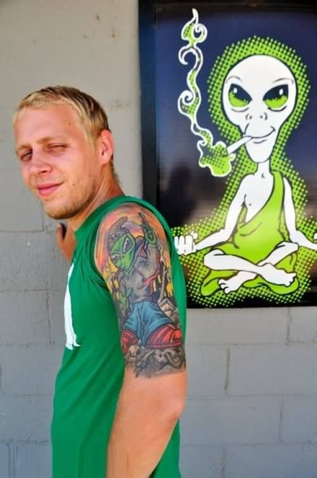 Attractive Green And Red Color Ink Funky Alien Tattoo For Man