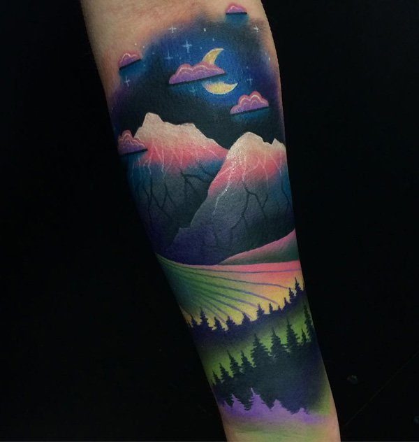 attractive mountain tattoo on arm With colourful ink For Man And Woman