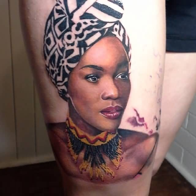 Attractive Yellow And Black Ink African Women Tattoo On Girl Thigh