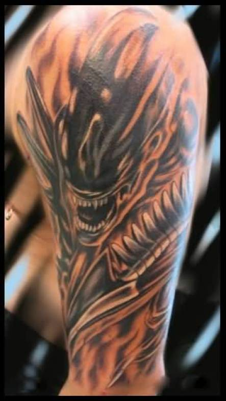 awesome red and gray color ink Tattoo Of Predator For Man's Sleeve made by expert