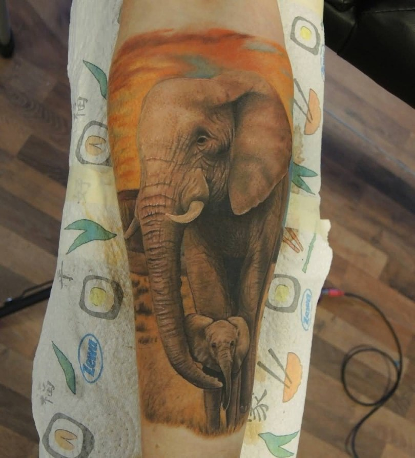 Awesome Yellow Color Ink Tattoo Of African Baby Elephant