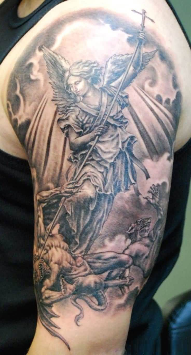 beaitoful gray color ink angel warrior tattoo on boy's shoulder for boys only made by expert artist