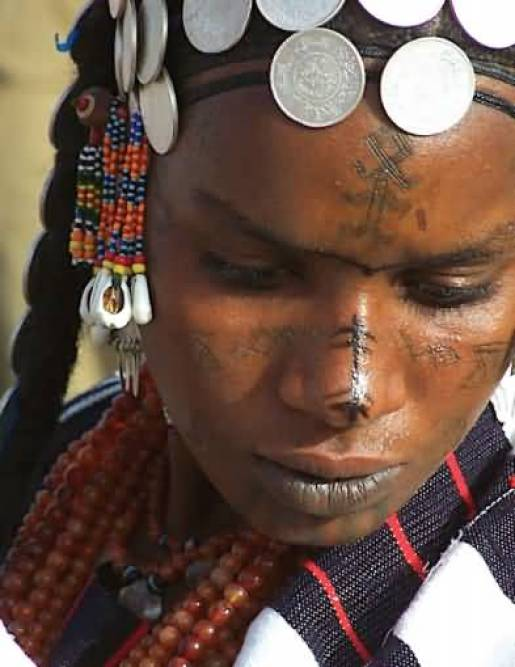 Beautiful African Culture Tattoo On Girls Nose And Cheeks