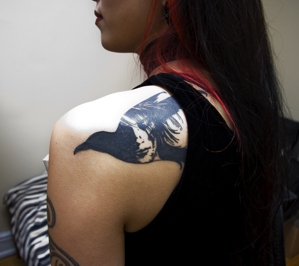 beautiful Raven Tattoo on Back for Women on back with Black ink For Man And Woman