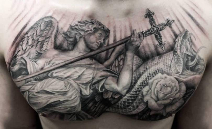 beautiful black color ink angel tattoo on boy chest for boys made by expert artist Angel Chest Tattoo