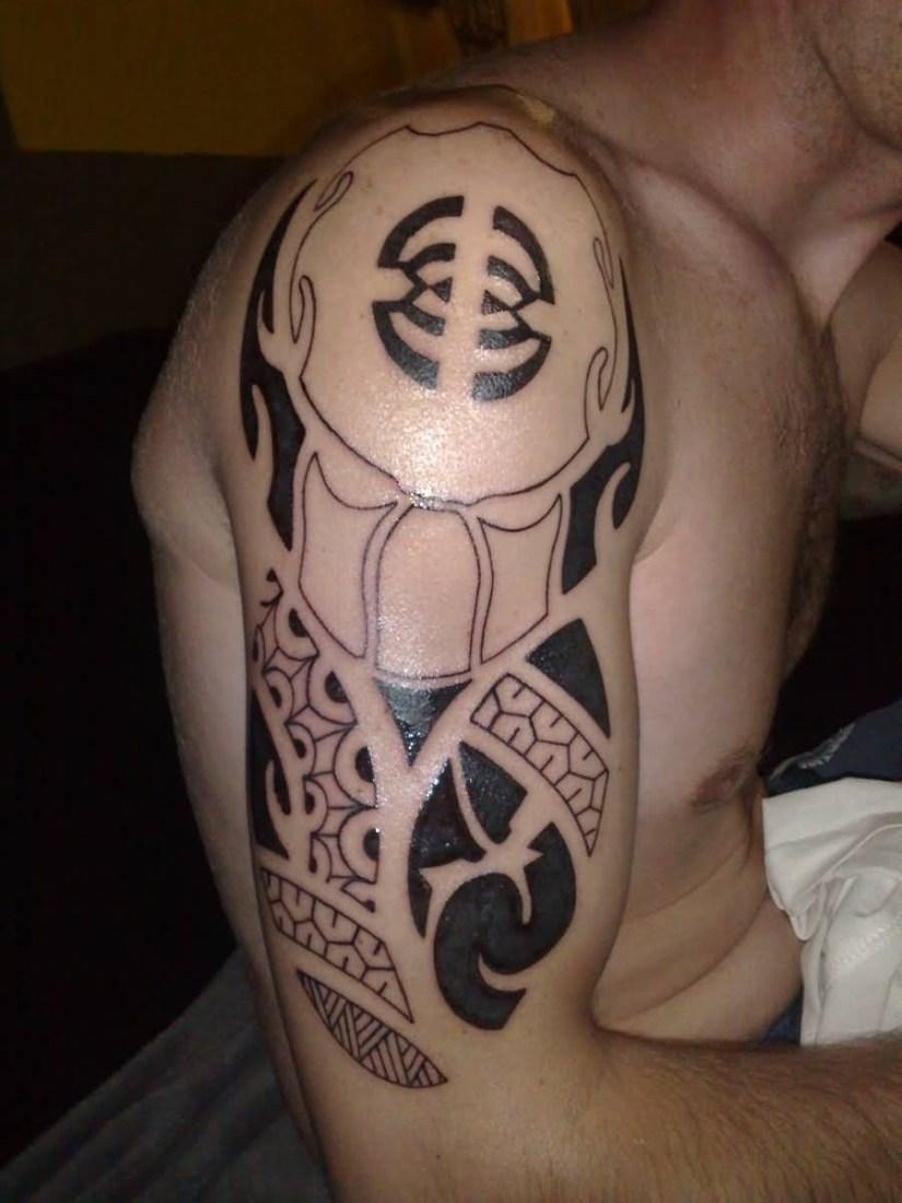 best ever black color ink Predator Symbol Tattoo on man shoulder for boys