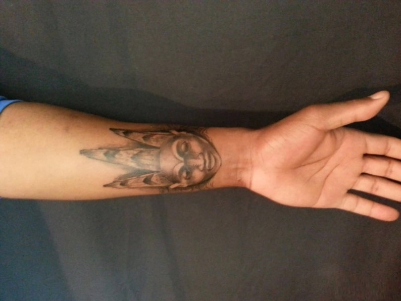Best Ever Gray Ink African Mask Tattoo On Boy Arm For Man