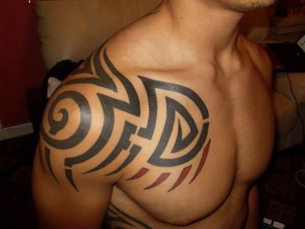 Cool Gray Color Ink African Tribal Tattoo On Boy Shoulder