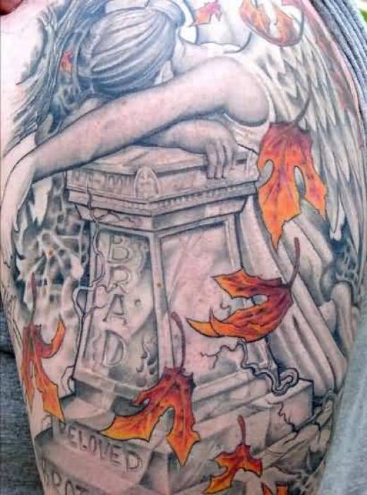 coolest red and gray color ink angel tattoo on boy sleeve for boys made by expert artist