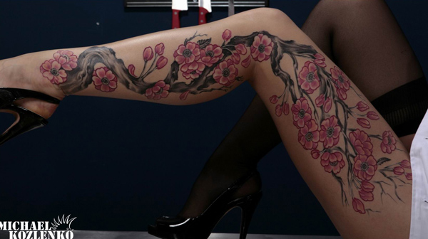 Woman tattoo in black and colorful ink for tattoo lovers for Womens leg tattoos