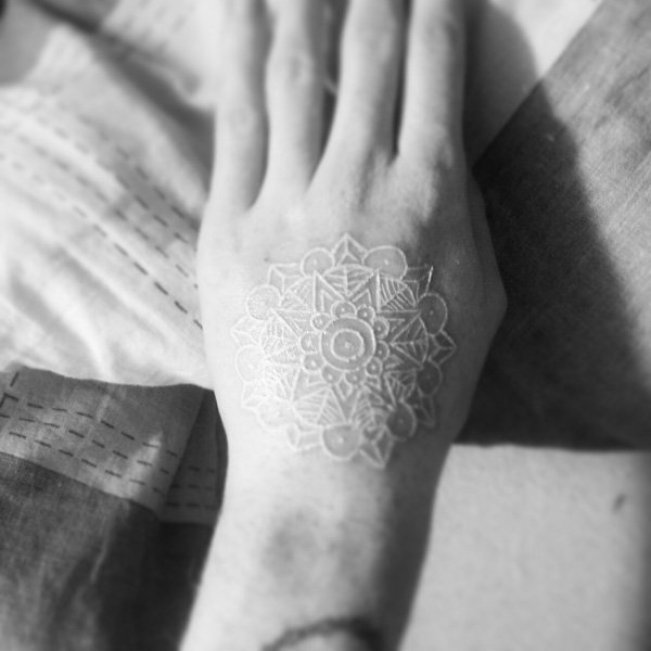 cutest White Ink Tattoos on Hand on hand white ink For Man And Woman