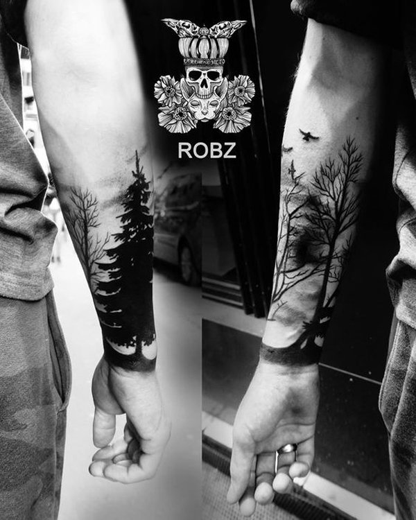 dashing forest with birds forearm tattoo for man on wrist With Black ink For Man And Woman