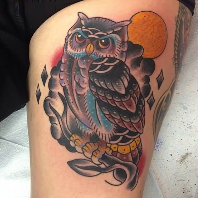 elegant red black yellow color ink animated owl tattoo on girl's thigh for girls only made by expert