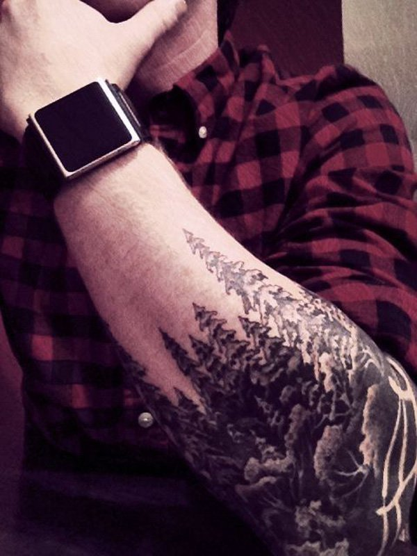 eye catching forest sleeve tattoo for man on elbow With Black ink For Man And Woman