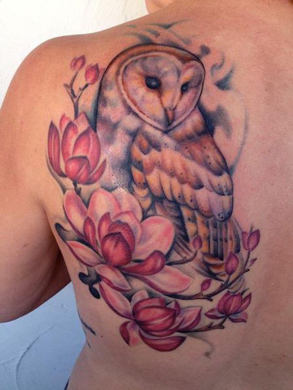eye catching magnolia and owl tattoo on back With colourful ink For Man And Woman