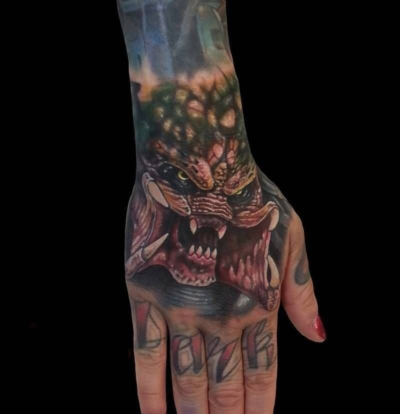 fabulous red and yellow color ink Scary Predator Tattoo On Hand made by expert